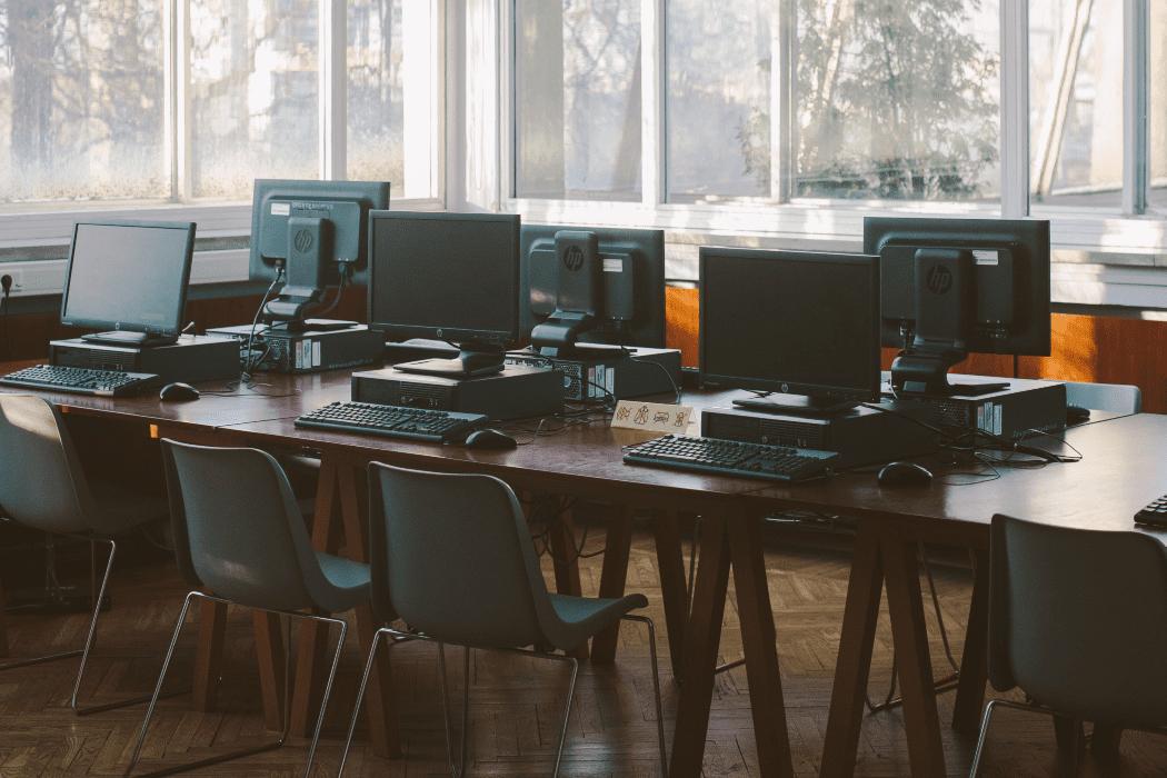 Desktop computers on desks