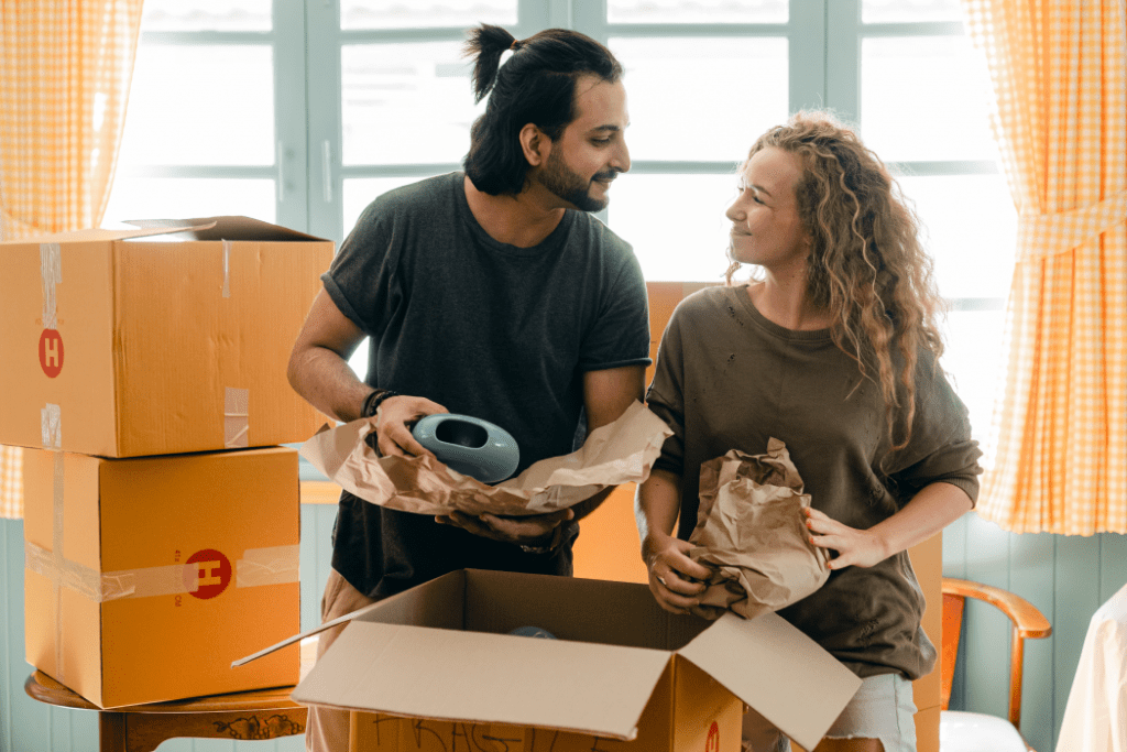Couple unboxing items in a new home