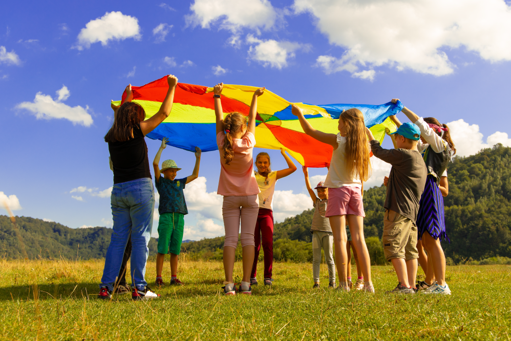 Children playing with a parachute in a circle