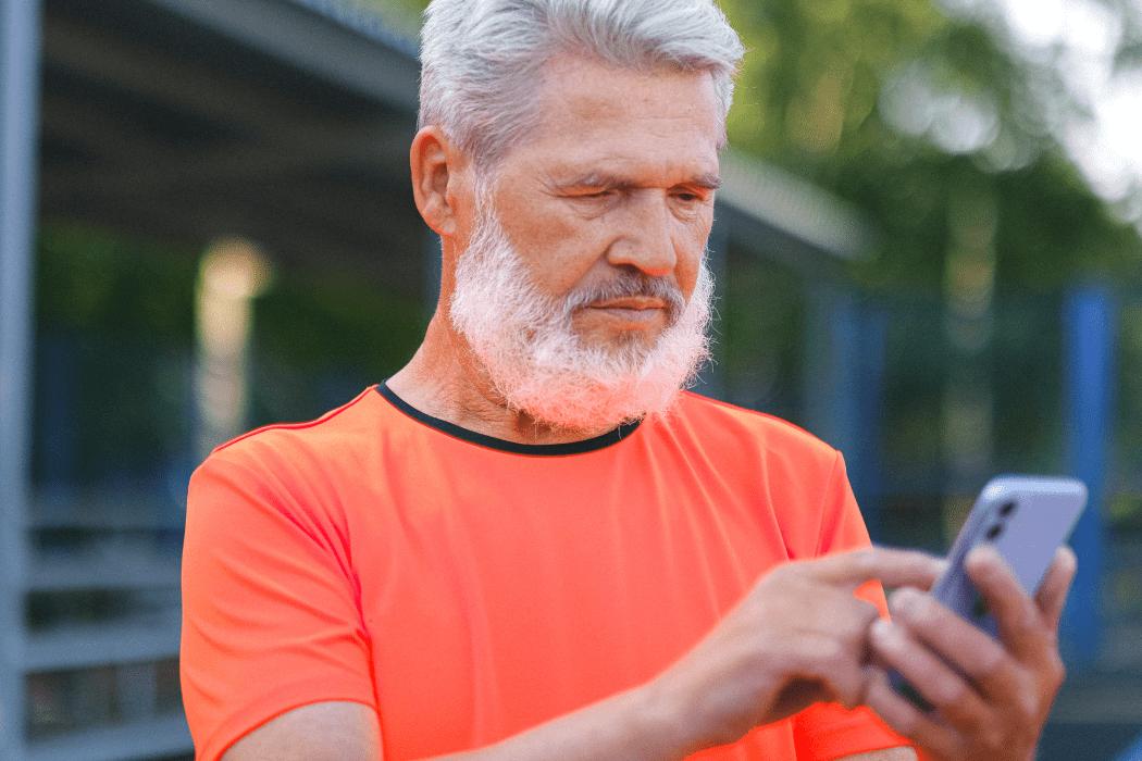 Senior man using cellphone for online banking