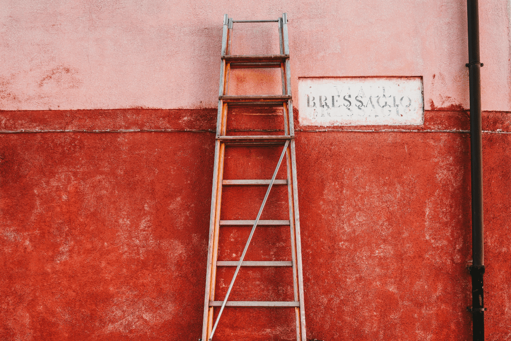 Ladder leaning up against a wall