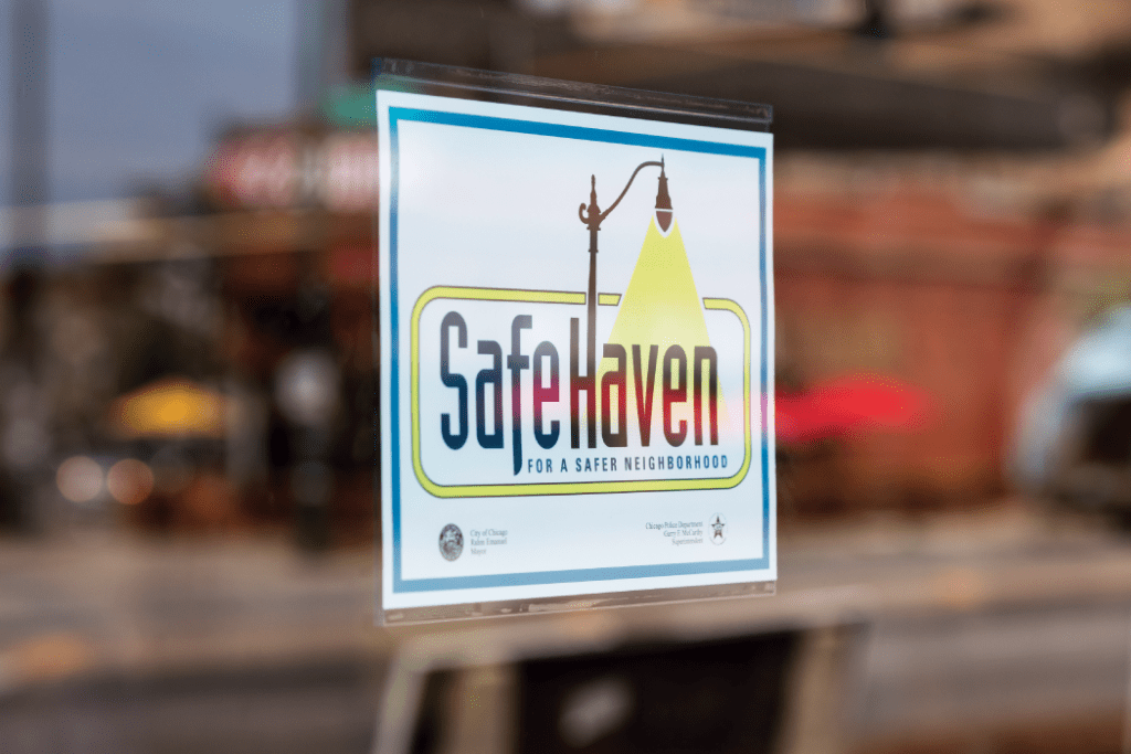 Safe Haven sign hanging in Liberty Bank window