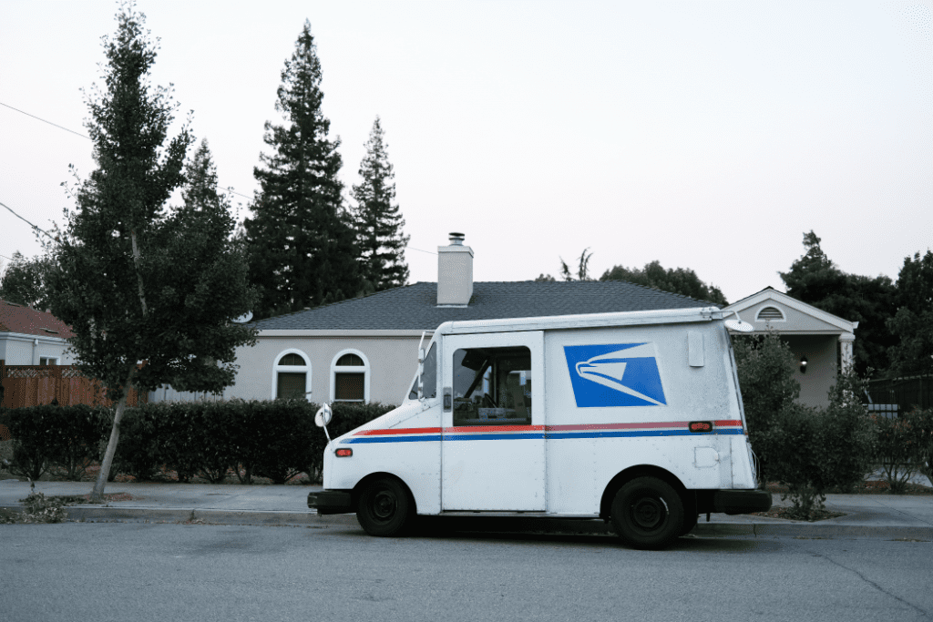USPS truck outside of a residential home