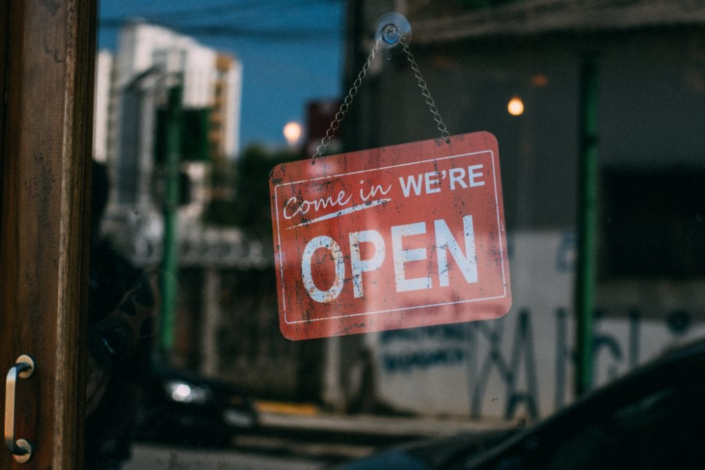 We're open sign hanging in a window