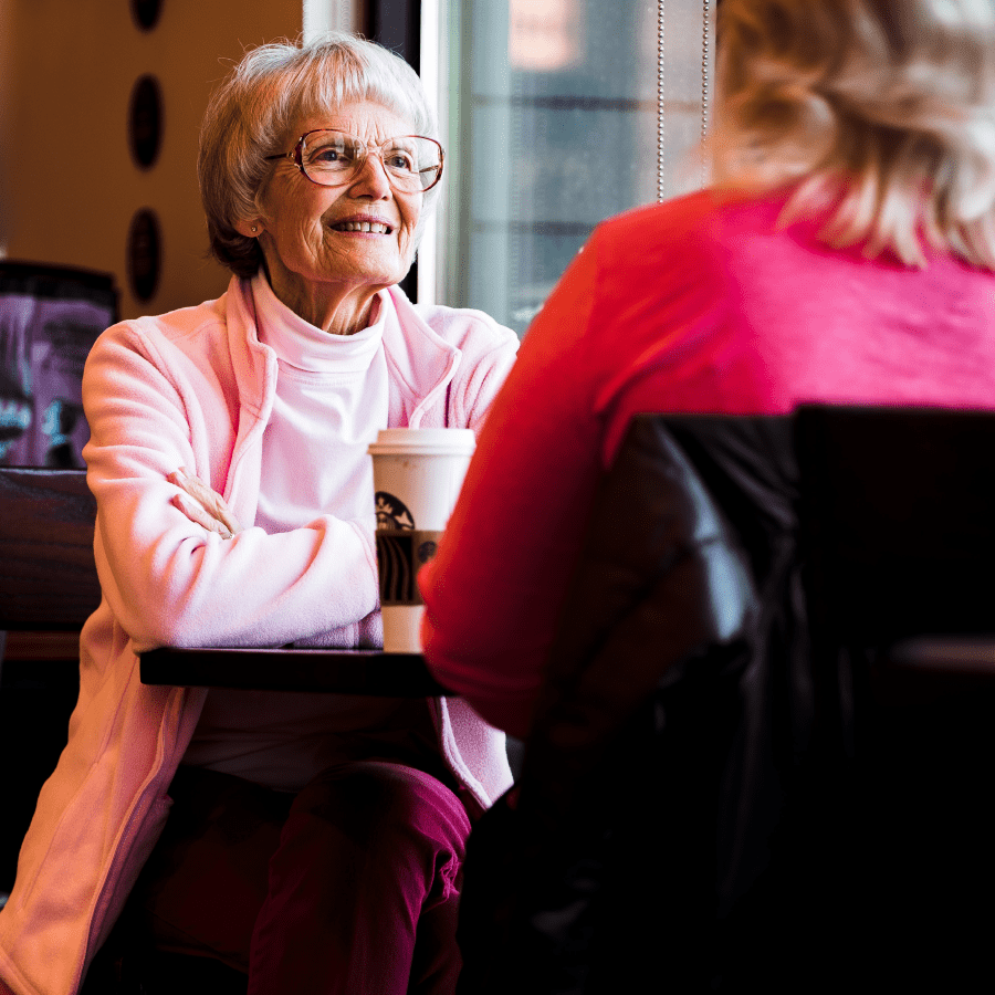 Senior woman talking with a friend