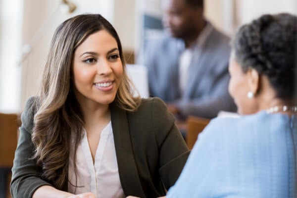woman banker sitting with a client