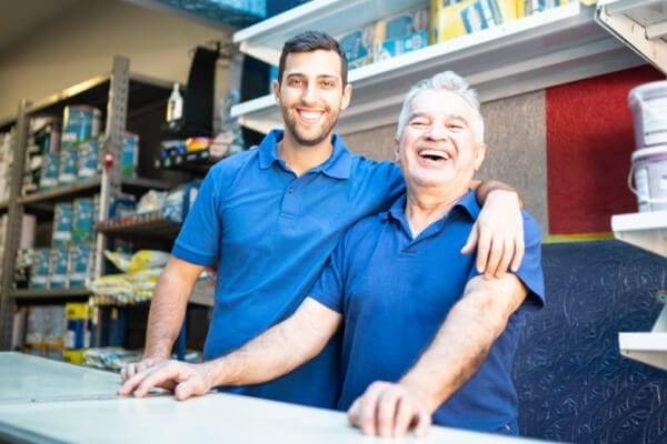 Liberty Bank customers and father and son duo smiling