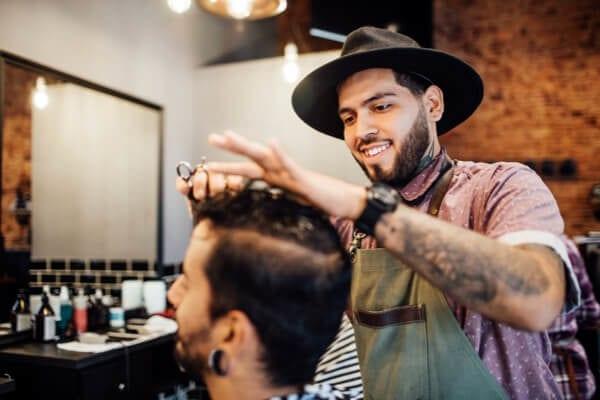 barber cutting a customers hair