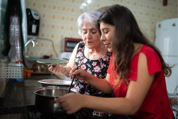 mother and daughter cooking a meal