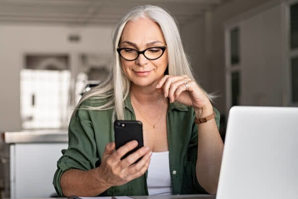 middle-aged woman looking at a cell phone